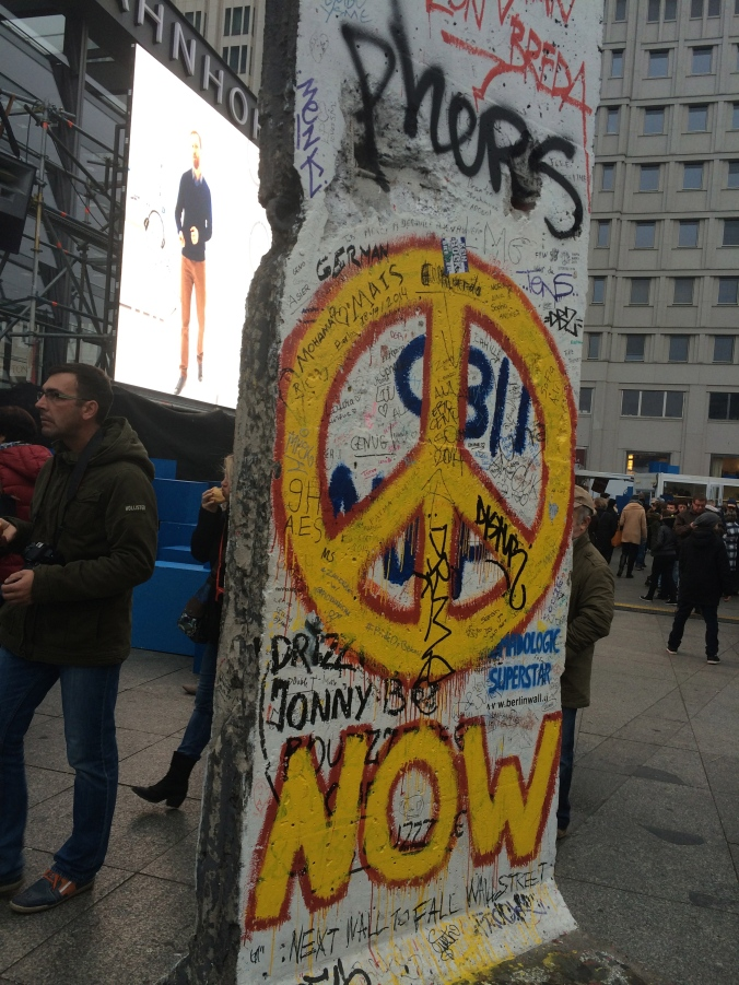 A piece of the Berlin Wall in Potsdamer Platz commemorating both the Wall that once was and the peaceful protest that brought it down
