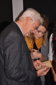 Mr. Klaus Dittmer sharing with me his passport stamps from the GDR