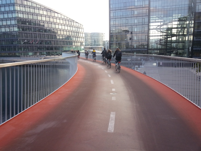 "Riding our bicycles along ""the Snake,"" a bike-only route in Copenhagen, Denmark."