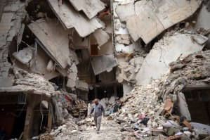 A Syrian man walks amid destruction in the northern Syrian city of Aleppo on April 10, 2013 DIMITAR DILKOFF/AFP/Getty Images