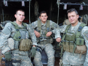 Colin Blevins (center) with team members at Fort Polk, LA 2010.