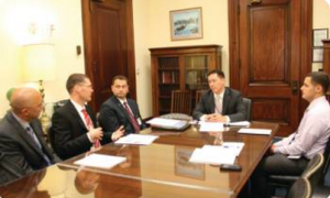 Colin Blevins (right) and OutServe members sharing their stories with Congressional Aide at Capitol Hill, Washington, D.C. 2012.